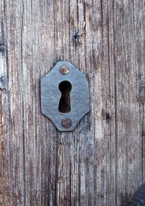 The outside world is viewed through a keyhole.