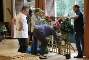 Preparing the set in the church hall. (PHOTO: PHIL MANSELL)
