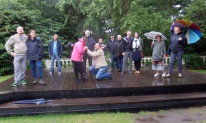 Linlithgow Players on the rain-soaked stage where they were due to perform. (PHOTO: PHIL MANSELL)